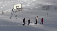 Children walking in the snow Stock Footage