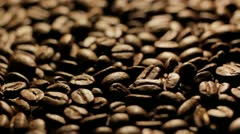 Coffee beans turning close up Stock Footage