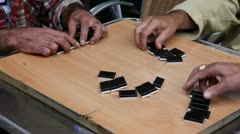 Retired persons senior citizens play Domino time lapse Stock Footage