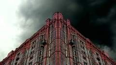 Timelapse storm clouds behind old derelict victorian warehouse Stock Footage