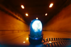 Car With Blue Emergency Light Driving Through A Tunnel - stock footage