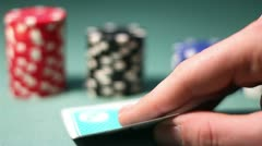 Poker Player Looks His Hand Carefully Stock Footage