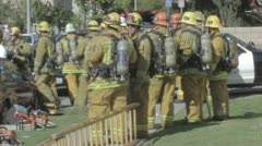 Group of firefighters standing by in full gear at SWAT and fire situation Stock Footage
