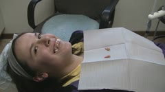 Stock Footage - Teenage Girl - Braces - Two Teeth Pulled - roots not spread #2 Stock Footage