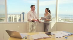 Two business associates working  in office Stock Footage