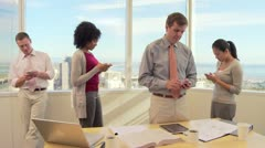 Business associates in office texting on cell phones - stock footage