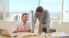 Business collegues discussing work in office Stock Footage