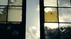 Apocalypse grunge broken window glare sun 1080p HD Stock Footage