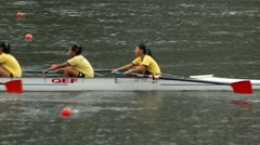Crew boat teams race on a river Stock Footage