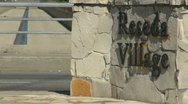 Stock Video Footage of Reseda Village , the inscription on irregular stone slabs