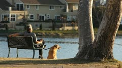 MAN AND DOG WATCH WORLD GO BY Stock Footage