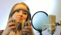 The young girl sings in the profi audio studio Stock Footage