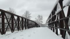 Trail's bridge covered in snow - stock footage