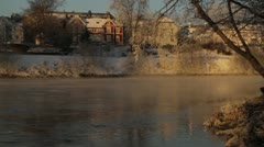 Frosty Smoke on a river during the winter season Stock Footage