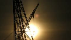 Sunset behind industrial cranes Stock Footage