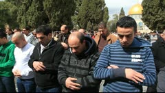 Prayers outside Al Aqsa Mosque, Jerusalem - stock footage
