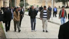 Men walking towards Al Aqsa Mosque in Jerusalem Stock Footage
