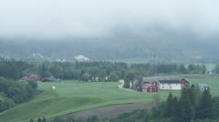Farms in green, misty valley Stock Footage