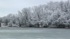 Partly frozen lake in frosty day 3 Stock Footage