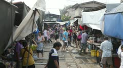View from Train going through a Thai Market Stock Footage