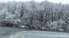 Partly frozen lake in frosty day Stock Footage