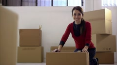 Happy woman smiling at home during move with boxes Stock Footage