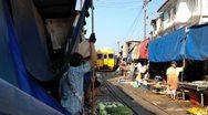 Stock Video Footage of Train going through a Thai Market