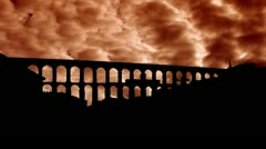 Spain Aqueduct of Segovia west orange clouds Stock Footage