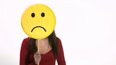 Sad young woman using emoticon for emotions Stock Footage