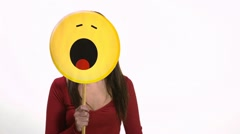 Bored young woman using emoticon for emotions Stock Footage