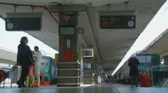 Travelers on Naples train platform Stock Footage