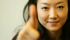 Beautiful young asian woman smiling with thumb up Stock Footage