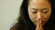 Stock Video Footage of Young asian woman putting hands together to pray
