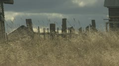 Grass and abandoned houses of the old village Stock Footage