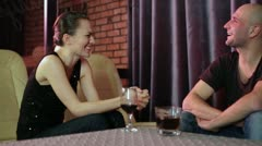 Young attractive couple looking at each other and chatting in the bar Stock Footage