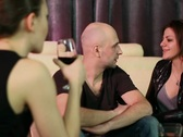 Two young attractive women and man at a night party Stock Footage