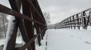 Stock Video Footage of Close up of small trail bridge covered with snow