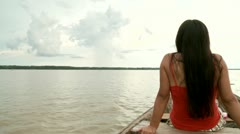 Woman in Canoe On Amazon River Stock Footage