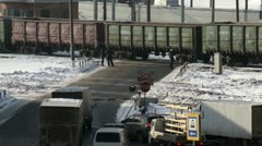 Cars stop near cross road with cargo train Stock Footage