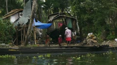 Indians work near a river - stock footage