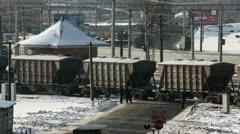 Cargo train on cross road in winter city Stock Footage