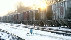 Cargo train move on rail road at winter sunset Stock Footage
