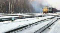 Winter rail road with cargo locomotive Stock Footage