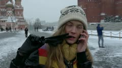 HD1080p25 Sexy woman with knit cap talking on cell phone on Red Square in Stock Footage