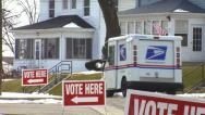 Stock Video Footage of 'Vote Here' with US Postal Truck