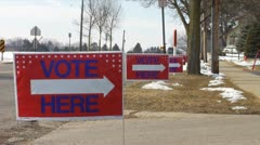 'Vote Here' Signs - stock footage