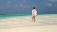 beautiful girl is on the shallow sea - stock footage