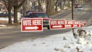 Stock Video Footage of 'Vote Here' Signs