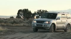 SUV pulls onto a dirt road Stock Footage