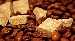 Grains of coffee and pieces of reed sugar Stock Footage